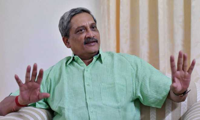 Parrikar makes appearance in Rajya Sabha; Cong protests