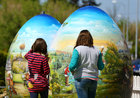 Children look at two-metre-high Easter eggs painted in the traditional naive art style in Koprivnica, Croatia, April 9. Reuters