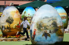 A boy runs among two-metre-high Easter eggs painted in the traditional naive art style in Koprivnica, Croatia, April 9. Reuters