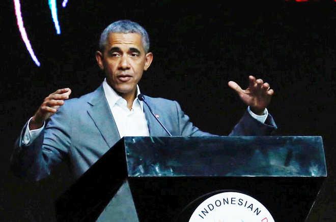 Barack Obama urges world to stand against 'aggressive nationalism'