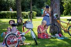 Participants in the 5th Lady on Bicycle annual festival rest in the shade at Sokolniki park in Moscow on August 6, 2017. AFP