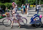 A participant in the 5th Lady on Bicycle annual festival pushes her bike in the Sokolniki park in Moscow on August 6, 2017. AFP