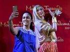 A girl taking selfie with the newly unveiled wax-statue of legendary actress Madhubala at Madame Tussauds Delhi on Thursday. PTI