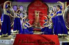 Artists perform at the unveiling of a wax-statue of legendary actress Madhubala at Madame Tussauds Delhi on Thursday. PTI