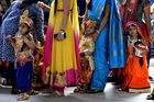 Children dressed as Hindu deity Krishna and his consort Radha stand in line with their mothers during an enactment competition as part of Krishna Janmashtami celebrations in Bangalore on August 12, 2017. Krishna Janmashtami also known as Gokulashtami, is an annual Hindu festival that celebrates the birth of Krishna, the eighth avatar of Lord Vishnu. AFP photo