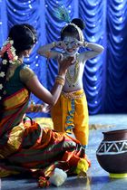 A mother and her child dressed as Yashodha and her son dressed as Hindu deity Krishna wait for their turn during an enactment competition as part of Krishna Janmashtami celebrations in Bangalore on August 12, 2017. Krishna Janmashtami also known as Gokulashtami, is an annual Hindu festival that celebrates the birth of Krishna, the eighth avatar of Lord Vishnu. AFP photo