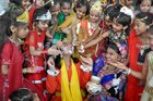Children dressed as Hindu deity Krishna and his consort Radha stand in line with their mothers during an enactment competition as part of Krishna Janmashtami celebrations in Moradabad on August 12, 2017. PTI photo