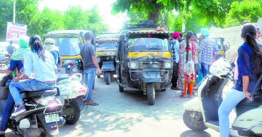 Auto-rickshaws continue to choke city roads