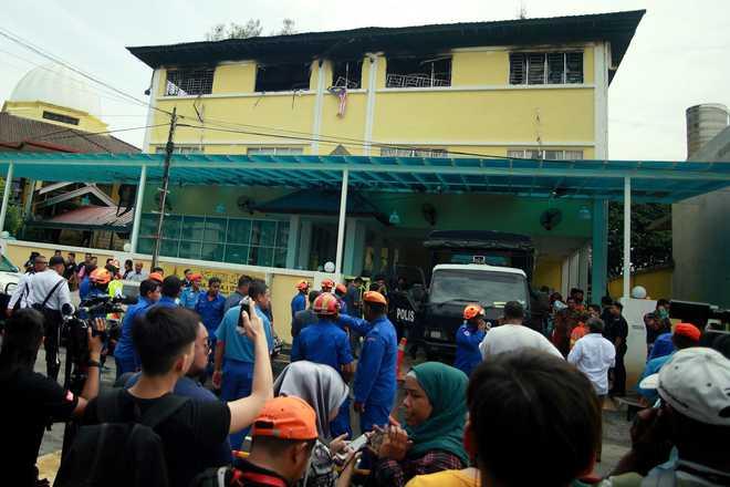 Boys 'cried from barred windows' as school blaze kills 23 in Malaysia