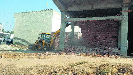 BJP leader's shops demolished, alleges political vendetta