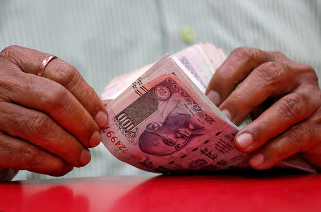 Rupee hits new low of 74.39, plunges 21 paise against strong dollar