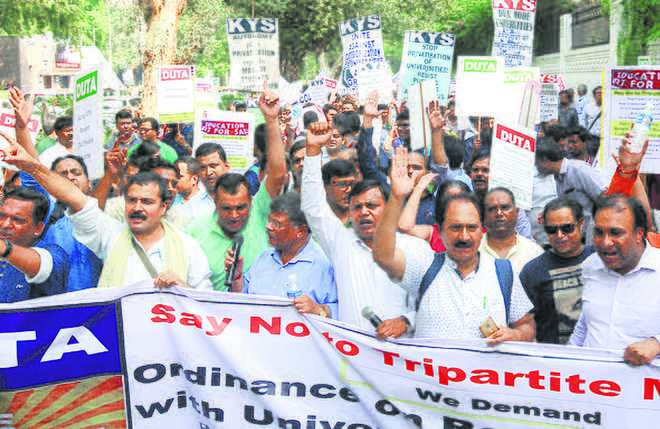 DUTA marches against Centre's tripartite MoU, MHRD's freeze on permanent appointments