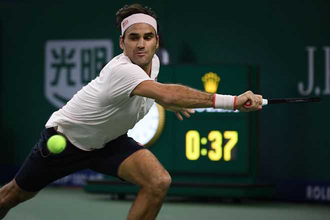 Federer stretched but pulls through for family