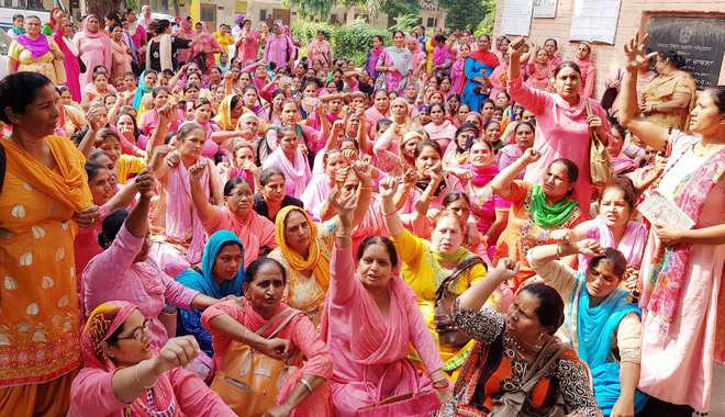 Asha workers stage protest, demand hike in wages