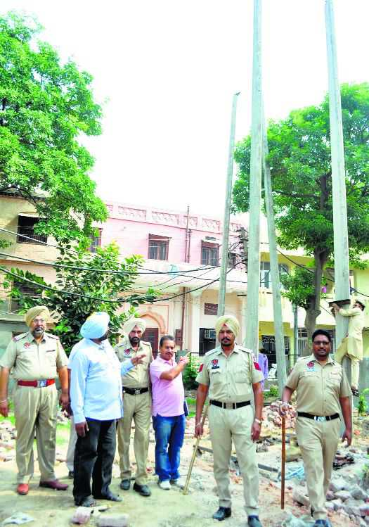 PSPCL officials shift transformer amid protest by residents