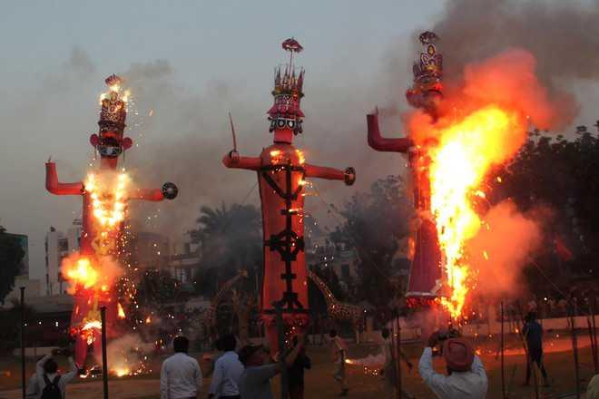 City celebrates as demon king burns