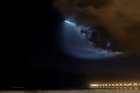 A SpaceX Falcon 9 rocket lights up the evening sky over Oceanside, California as it carries an Argentinian Earth-observing satellite into space after blasting off from Vandenberg Air Force Base, California, US, on October 7, 2018. Reuters