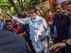 Bollywood actor Amitabh Bachchan greets fans who had gathered outside his bungalow on his 76th birthday, in Mumbai, October 11. PTI