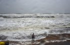 A person is seen along the coastline as Cyclone Titli hits the city, starting with surface wind effect reaching speeds of 126 kmph at Gopalpur, in Ganjam, October 11. PTI