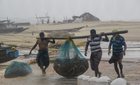 Fishermen engaged in their work as Cyclone Titli hits the coast starting with surface wind effect reaching speeds of 126 kmph at Gopalpur, in Ganjam, October 11. PTI