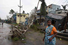 A woman stands next to a damaged communication tower after cyclone Titli hit in Srikakulam district in the southern state of Andhra Pradesh, October 11. Reuters