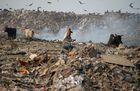 Smoke rises from a garbage dump at the Bhalswa landfill site in New Delhi, on October 29, 2018. AFP photo