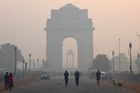 Indian pedestrians walk near the India Gate monument amid heavy smog conditions in New Delhi on October 30, 2018.  — AFP