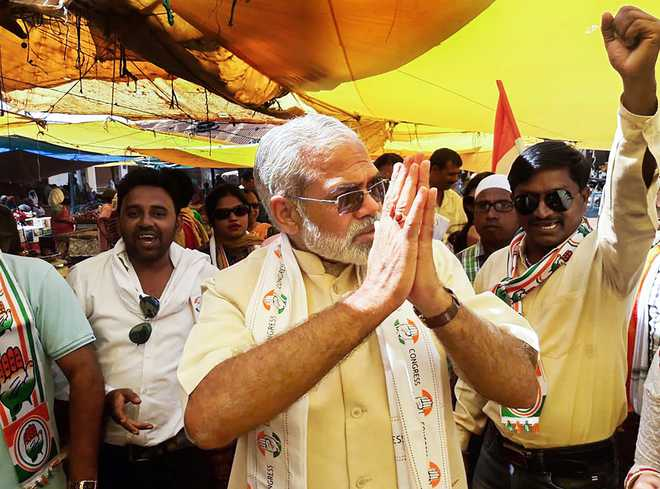 Modi lookalike switches over to Congress, says 'achche din' won't come