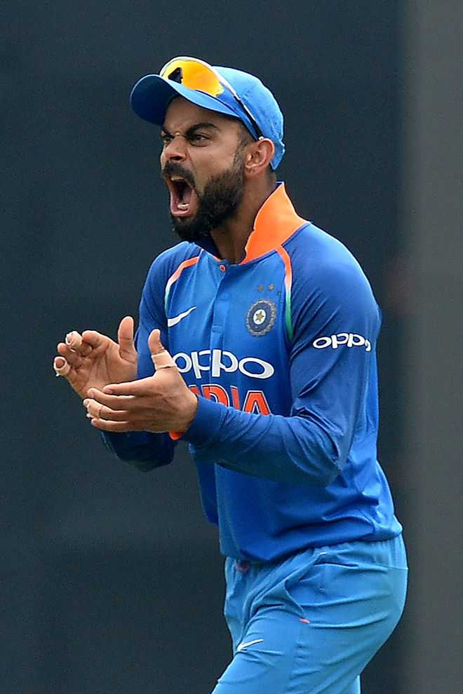 Kohli tells fan to quit India for liking Aus, Eng players, later plays it down