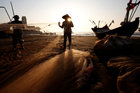 Fishermen clean their nets at a beach in Nam Dinh province, Vietnam, November 2. Reuters