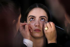 A model has her makeup done backstage during the Mercedes-Benz Fashion Week Tbilisi, Georgia, November 2, 2018. — Reuters