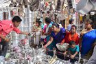 People buy utensils at a shop on the occasion of Dhanteras festival, in Allahabad, November 5. PTI