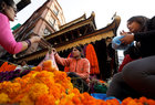 A street vendor sells garlands made of marigold flowers along the streets during the Tihar festival, also called Diwali, in Kathmandu, Nepal November 5. Reuters