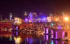 Participants light earthen oil lamps on the banks of the Sarayu river in an attempt to enter the Guinness World Records for the largest display of oil lamps on the eve of Diwali, the Hindu festival of lights, in Ayodhya. Reuters