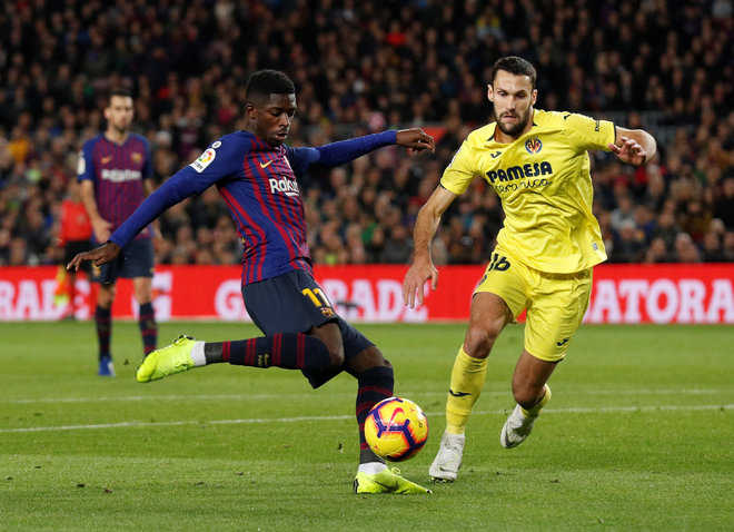 Dembele takes Barca to top with win over Villarreal