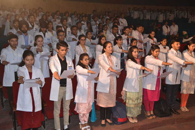 Medical students pledge allegiance to their profession