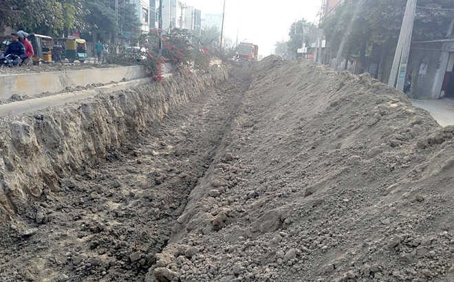 Shopkeepers suffer as Majitha Road yet to be re-carpeted