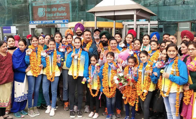 Gymnasts do city proud, receive warm welcome
