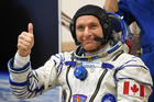 David Saint-Jacques of the Canadian Space Agency gestures as his space suit is tested prior to the launch onboard the Soyuz MS-11 spacecraft at the Russian-leased Baikonur cosmodrome in Kazakhstan on December 3. AFP