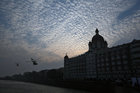 Indian Navy helicopters fly past Taj Mahal hotel during Navy Day celebrations in Mumbai, December 4. Reuters