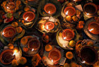Oil lamps along with various offerings offered by the devotees are kept at Pashupatinath Temple, during the Bala Chaturdashi festival, in Kathmandu, Nepal December 5. The festival is celebrated by the worshippers by lighting oil lamps and scattering seven types of grains known as 'sat biu' honouring the departed along a route at the temple. Reuters