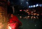A devotee offers prayers by lighting oil lamps at Pashupatinath Temple, during the Bala Chaturdashi festival, in Kathmandu, Nepal, December 5. Reuters