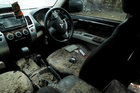 Interior of a damaged car is seen after a tsunami, near Sumur, Banten province, Indonesia, December 26. Reuters
