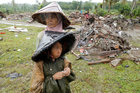 A woman and child are seen next to debris after a tsunami in Sumur, Banten province, Indonesia, on December 26. Reuters