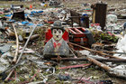 Debris and damaged property is seen after a tsunami, in Sumur, Banten province, Indonesia, December 26. Reuters