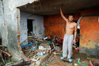 A man among the debris of a damaged house after a tsunami, in Sumur, Banten province, Indonesia, on December 26. Reuters