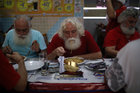 Students of the Brazil's school of Santa Claus eat spaghetti during a ritual named 'Barbas de Molho' to mark the end of Christmas season, in Rio de Janeiro, Brazil, December 26. Reuters