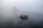 A boatman rows his boat in the Narmada river on a cold, foggy morning, at Gwarighat in Jabalpur, December 28. PTI