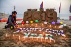A college student creates a sand sculpture on the New Year's Eve, at Sangam in Allahabad, December 31, 2018. PTI