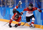 Dominique Ruegg of Switzerland and Yurie Adachi of Japan in action in ice hockey during the Pyeongchang 2018 Winter Olympics on February 12. Reuters